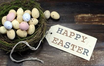 Easter eggs and Happy easter message on dark background