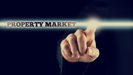 male hand activating a Property market button on virtual screen
