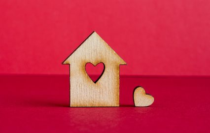 Wooden house or home with love heart